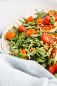 Roasted Tomato, Arugula and Halloumi Salad with Pesto | cookinginmygenes.com